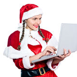 Woman santa claus christmas computer Royalty Free Stock Photo