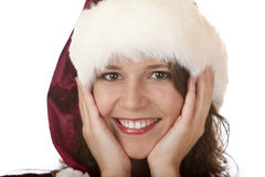 Woman with Santa Claus Christmas fur cap Royalty Free Stock Image