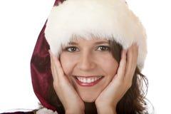 Woman with Santa Claus Christmas fur cap Royalty Free Stock Image