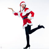 Woman santa claus christmas product placement. One woman dressed as santa claus product placemant showing empty hand on studio isolated white background Royalty Free Stock Photos