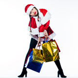Woman santa claus christmas shopping Royalty Free Stock Photography