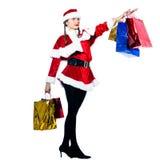 Woman santa claus christmas shopping proud Stock Photos