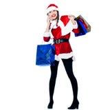Woman santa claus christmas shopping telephone Royalty Free Stock Photography