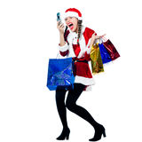Woman santa claus christmas shopping telephone. One woman dressed as santa claus carrying screaming on the telephone christmas bags  on studio isolated white Stock Photography