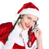 Woman santa claus christmas telephone Stock Images