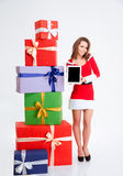 Woman in santa claus cloth showing blank computer screen Stock Photos
