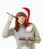 Woman in Santa Claus clothes with beauty cosmetics Stock Photo
