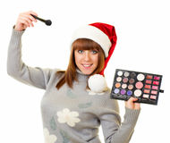Woman in Santa Claus clothes with beauty cosmetics Royalty Free Stock Image