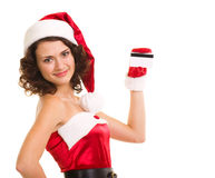 Woman in Santa Claus clothes with credit card Royalty Free Stock Photography