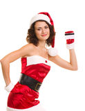 Woman in Santa Claus clothes with credit card Royalty Free Stock Image