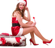 Woman in Santa Claus clothes dreaming Stock Photo