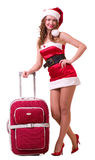 Woman in Santa Claus clothes dreaming Royalty Free Stock Photography
