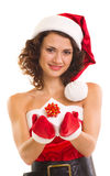 Woman in Santa Claus clothes with gift Royalty Free Stock Photography