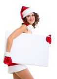 Woman in Santa Claus clothes leaning on blank boar Stock Photography