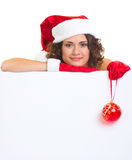 Woman in Santa Claus clothes leaning on blank boar Royalty Free Stock Image
