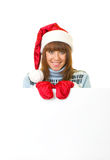 Woman in Santa Claus clothes leaning on blank boar Royalty Free Stock Photo