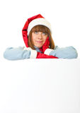 Woman in Santa Claus clothes leaning on blank boar Stock Images