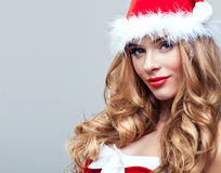 Woman in Santa Claus clothes Stock Photo