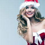 Woman in Santa Claus clothes Stock Images