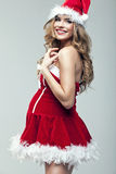 Woman in Santa Claus clothes Royalty Free Stock Photos