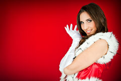Woman in santa claus clothes posing Royalty Free Stock Photography