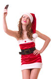 Woman in Santa Claus clothes with telephone Stock Photography