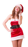 Woman in Santa Claus clothes with telephone Royalty Free Stock Photos