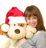 Woman in Santa Claus clothes with toy dog Stock Photography