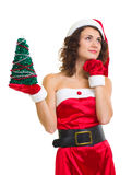 Woman in Santa Claus clothes with tree Royalty Free Stock Photography