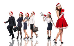 Woman in Santa Claus costume with business people. Beautiful and sexy women wearing santa claus costume with her business team Royalty Free Stock Image