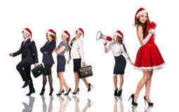 Woman in Santa Claus costume with business people. Beautiful and sexy women wearing santa claus costume with her business team Stock Photos