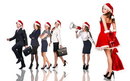 Woman in Santa Claus costume with business people. Beautiful and sexy women wearing santa claus costume with her business team Royalty Free Stock Photography