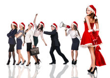 Woman in Santa Claus costume with business people. Beautiful and sexy women wearing santa claus costume with her business team on the white background Stock Photos