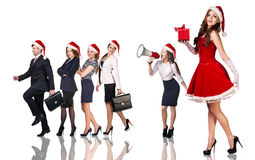 Woman in Santa Claus costume with business people. Beautiful and sexy women wearing santa claus costume with her business team on the white background Royalty Free Stock Photo