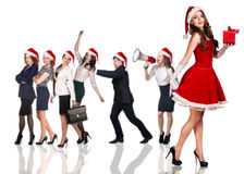 Woman in Santa Claus costume with business people. Beautiful and sexy women wearing santa claus costume with her business team on the white background Royalty Free Stock Photos