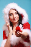 Woman santa claus costume holds gift boxes with ring on blue Royalty Free Stock Photography