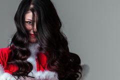 Woman in santa claus costume Royalty Free Stock Images