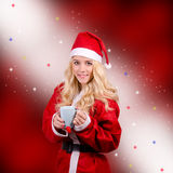 Woman in Santa Claus dress Stock Image