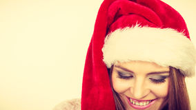 Woman in santa claus hat free and happy laughing Royalty Free Stock Image