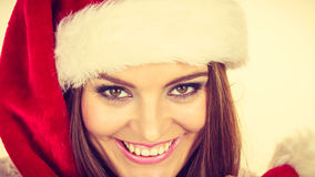 Woman in santa claus hat free and happy laughing Royalty Free Stock Photos