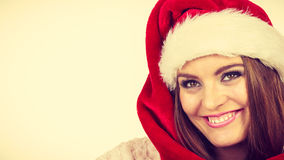 Woman in santa claus hat free and happy laughing Stock Photography