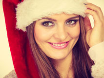 Woman in santa claus hat free and happy laughing Royalty Free Stock Photo