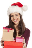 Woman with Santa Claus hat and a gift boxes Stock Photos