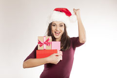 Woman with Santa Claus hat and a gift boxes Stock Images