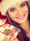 Woman santa claus hat with gingerbread cookie. Christmas Royalty Free Stock Photos