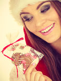 Woman santa claus hat with gingerbread cookie. Christmas Stock Image