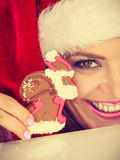 Woman santa claus hat with gingerbread cookie. Christmas Royalty Free Stock Photography