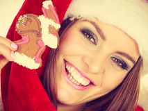 Woman santa claus hat with gingerbread cookie. Christmas Royalty Free Stock Photo