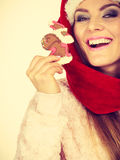 Woman santa claus hat with gingerbread cookie. Christmas Stock Photo
