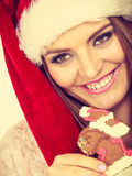 Woman santa claus hat with gingerbread cookie. Christmas Royalty Free Stock Image